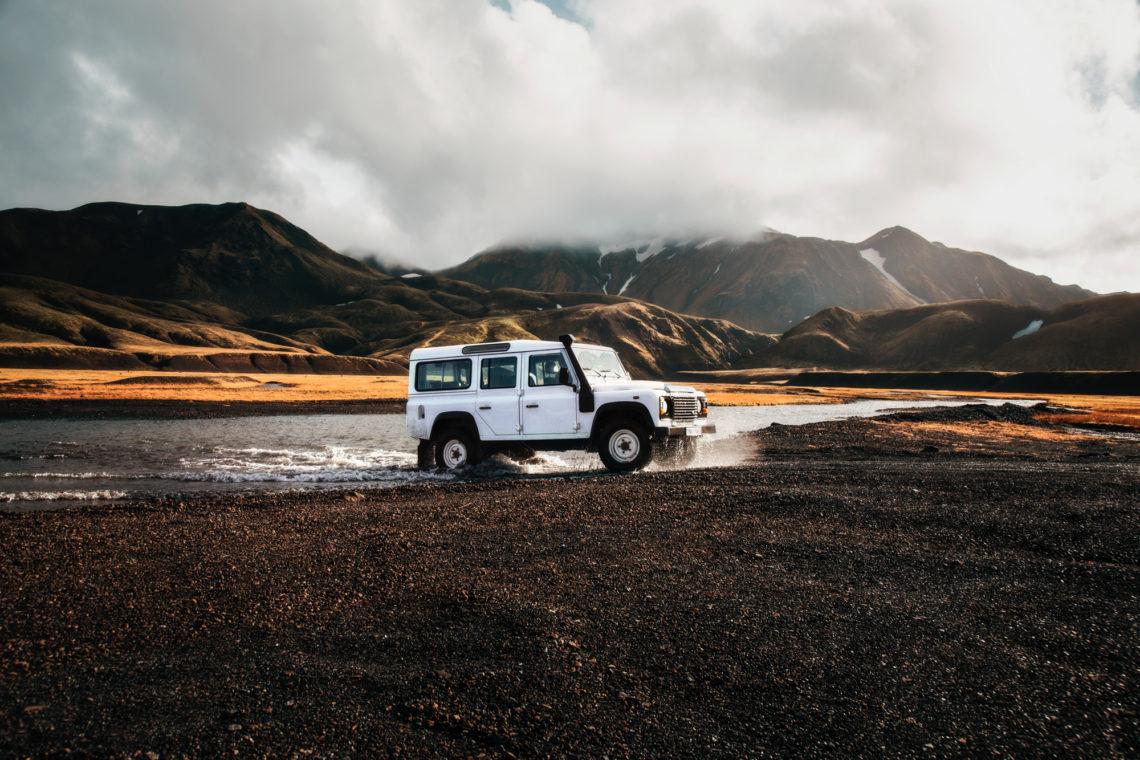 island auto sand wasser berge wolken